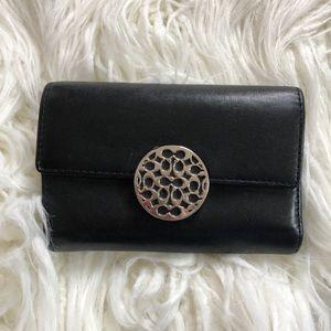 Black COACH leather wallet metal circle logo